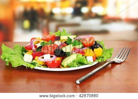 Tasty Greek salad on table in cafe