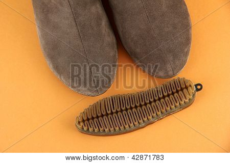 Brush for suede shoes, on color background
