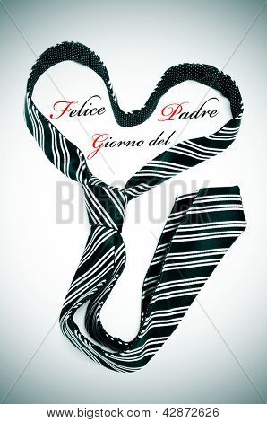 a tie forming a heart and the sentence felice giorno del padre, happy fathers day written in italian