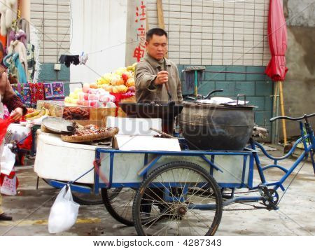 Man Selling Roasted Chestnuts On Street