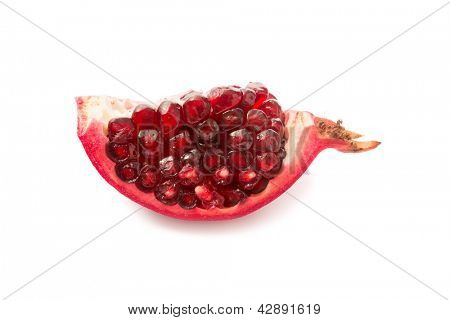 One section of a cut pomegranate showing the arils and membrane and seeds