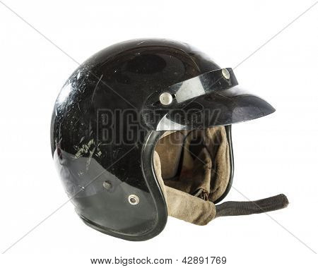Black used vintage motorcycle helmet isolated on white