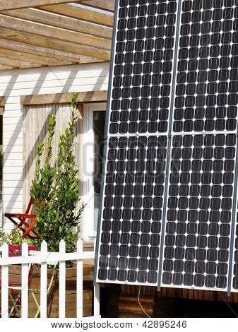 A wooden house with solar panel, sustainable development concept