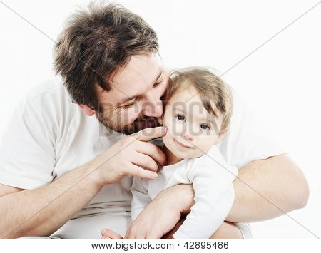 Happy father holding a smiling cute baby