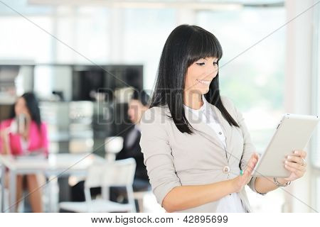 Portrait of a young successful businesswoman using tablet in office