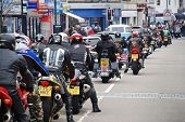 HASTINGS, ENGLAND - MAY 7: Motorcyclists ride through the streets during the annual May Day motorcyc