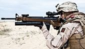 stock photo of special forces  - US marine in the desert through the military operation - JPG