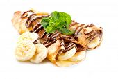 stock photo of crepes  - Crepes With Banana And Chocolate - JPG