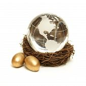 foto of nurture  - The world rests in the nurture of a wealthy nest for global finance concepts - JPG