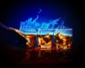picture of absinthe  - Image of three glasses of burning yellow absinthe - JPG