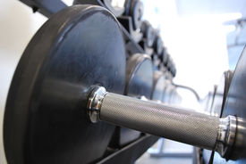 picture of weight-lifting  - Close up on rows of weights with point focus - JPG