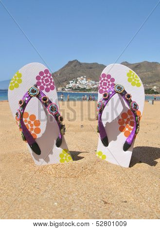 Flip-flops on the Teresitas beach. Tenerife island, Canaries