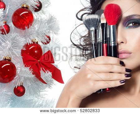 portrait of attractive  caucasian woman brunette isolated on white studio shot face closeup brushes skin makeup eyes hands nails