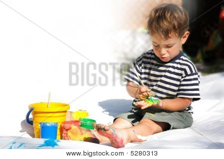 Young Boy Painting Outdoors Partly Isolated Over White