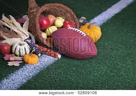 Football With A Cornucopia On A Grass Field
