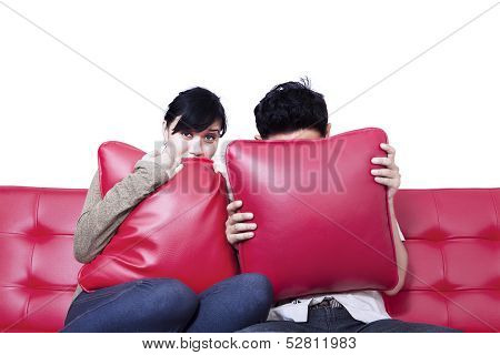 Scared Couple Watching Horror Movie