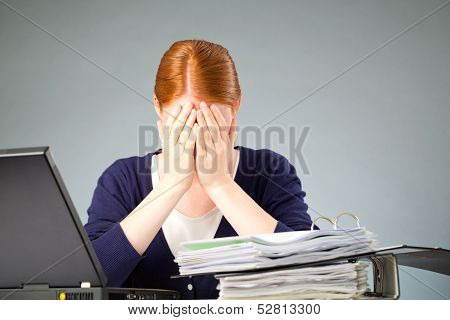 Businesswoman Experiencing Stress At Work