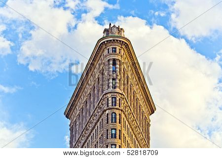 Facade Of The Flatiron Building  With Iron Statue Of Man On The Roof