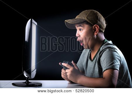 Asian Boy Excited With Computer Game With Expressing Face