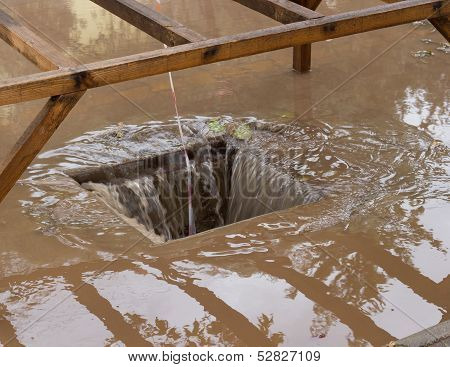 Drain With Heavy Rain Draining Away