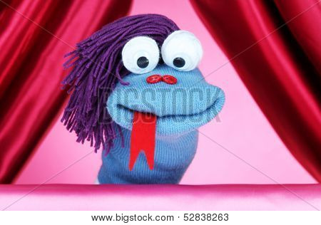 Puppet show on pink background