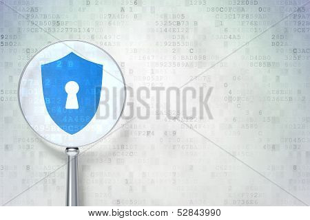 Security concept:  Shield With Keyhole with optical glass on digital background