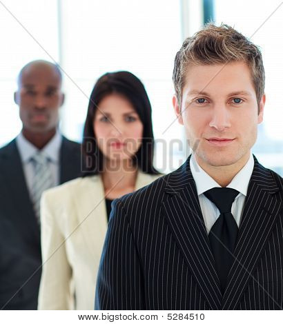 Portrait Of A Serious Businessman In Front Of His Team