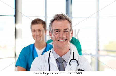 Senior Doctor Leading His Team
