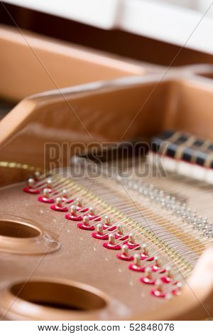 Close up of piano chords. Concept of music and entertainment