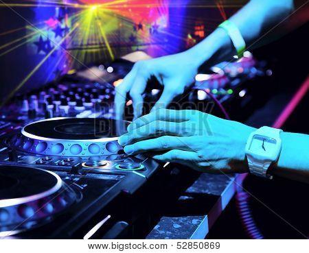 Dj Mixes the Track in Nightclub