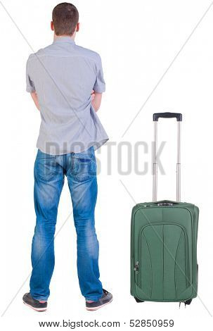 Back view of young man traveling with suitcas. Rear view people collection. backside view of person.  Isolated over white background.