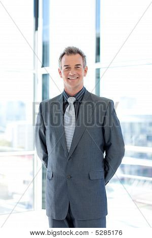 Confident Senior Manager In Office