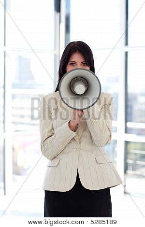 Brunette Businesswoman Shouting Through Megaphone