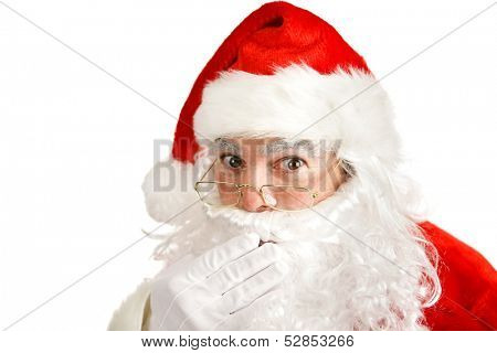 Closeup of Santa Clause covering his mouth like he has a secret he can't tell.  Isolated on white.