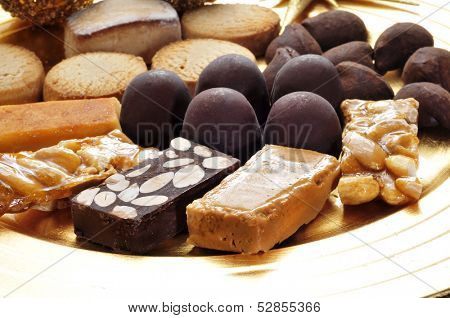 closeup of a tray with turron, mantecados and polvorones, typical christmas sweets in Spain