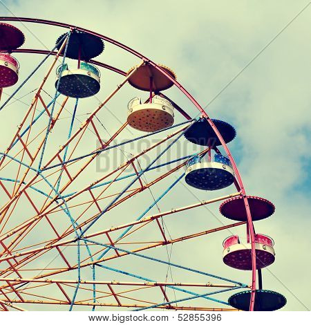 cutout of a Ferris wheel over the sky, with a retro effect