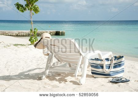 Sun Lounge On A Beach