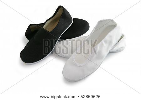 Black and white plimsoles