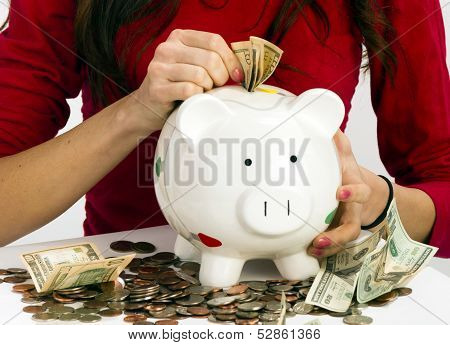 Woman Stuffing Us Currency Coins Piggy Bank Cash Savings
