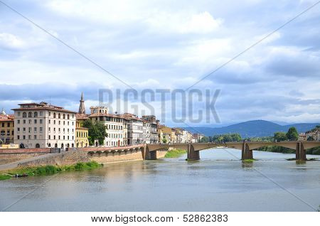 Picturesque view on Bridge alle Grazie over Arno River in Florence, Italy