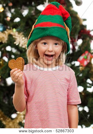 Elf Boy Holding Gingerbread Cookie