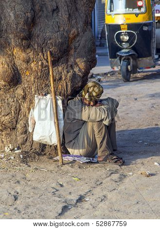 Indian Street Beggar Seeking Alms On The Street