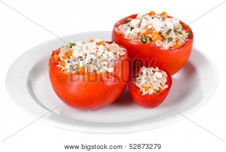 Stuffed tomatoes on plate isolated on white