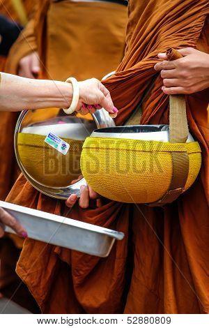 Giving for Buddhist monks.