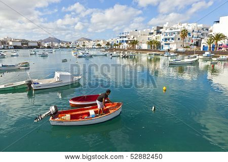 Fisherman Anchors The Boat In Charco De San Gines