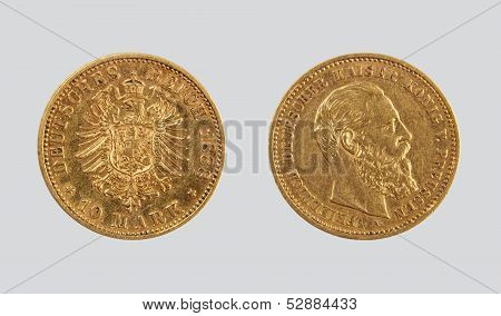 10 gold Reichsmarks, Kaiser's Germany, on a gray background