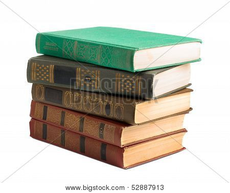 A Stack Of Old Books With Gold Stamping On A White Background Isolated