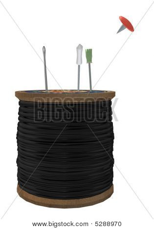 Thread Spool With Three Needles And A Tack