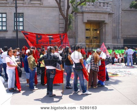 Protesters With Red Flags
