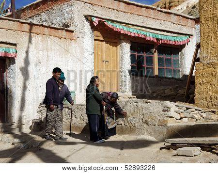 Children Are Elderly Parents In The Temple. Shigatse, China, Tibet, September 2011